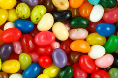 Assorted multicolored jelly beans. Close up of assorted multicolored jelly beans Stock Image