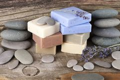 Assorted natural soap bars and pebbles Stock Photo