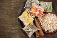Assorted natural soaps and bath salt Stock Photos
