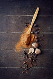 Assorted natural spices on wooden background Stock Image