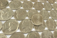 Assorted nickels. Several rows of nickels at an angle stock photography