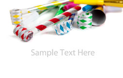 Assorted noise makers on white with copy space Royalty Free Stock Photos
