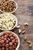 Assorted nut in  bowls Royalty Free Stock Photography