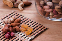Assorted nuts. On wooden kitchen table Stock Image