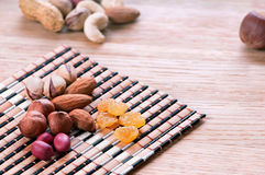 Assorted nuts. On wooden kitchen table Royalty Free Stock Photo
