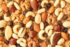 Assorted nuts. Abstract view of the mixture of nuts Stock Photo