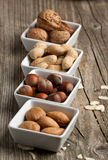 Assorted nuts almond, hazelnut and peanut Royalty Free Stock Photography