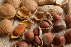 Assorted nuts almond, hazelnut and peanut Royalty Free Stock Images