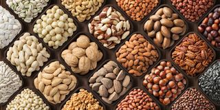 Free Assorted Nuts Background, Large Mix Seeds. Raw Food Products: Pecan, Hazelnuts, Walnuts, Pistachios, Almonds, Macadamia, Cashew, Stock Images - 148665844