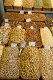 Assorted Nuts in Baskets. Assortment of raw nuts in woven baskets at a street market Royalty Free Stock Photo