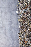 Assorted nuts and bolts on metal background Stock Photo