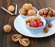 Assorted nuts in bowls Stock Photo