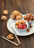 Assorted nuts in bowls Royalty Free Stock Images