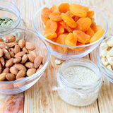 Assorted nuts in bowls Royalty Free Stock Photos