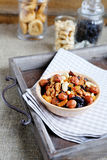 Assorted nuts in ceramic bowl on a tray Royalty Free Stock Photos
