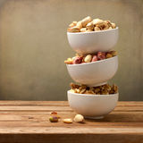 Assorted nuts in dishes Stock Image