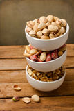 Assorted nuts in dishes Stock Photos