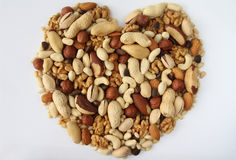 Assorted nuts in the form of heart. S on a white background Stock Photography