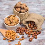 Assorted nuts: hazelnut, almonds, walnuts on wooden background Stock Photos