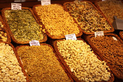 Assorted nuts on market stand Stock Photo