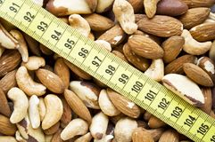 Assorted nuts with measure tape Stock Photos