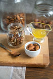 Assorted nuts: walnuts, almonds, hazelnuts and honey Stock Image