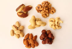 Assorted nuts. On a white background Royalty Free Stock Images