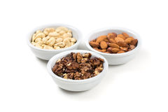Assorted nuts in white bowls. Isolated on white background Stock Image