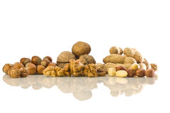 Assorted Nuts on white. Walnuts, hazelnuts and peanuts with reflection on white isolated  background Stock Photos