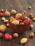 Assorted nuts in a wooden bowl Royalty Free Stock Photos