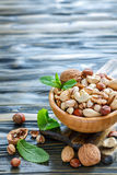 Assorted nuts in a wooden bowl. Stock Photo