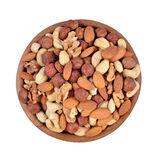 Assorted nuts in a wooden bowl on a white background Royalty Free Stock Images