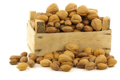 Assorted nuts in a wooden box Stock Photos