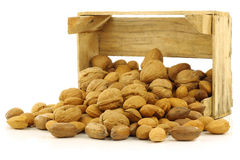 Assorted nuts in a wooden box Stock Photography