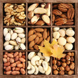 Assorted nuts in wooden box Stock Photography