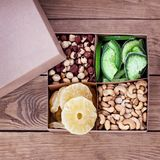 Assorted nuts in a wooden box royalty free stock photos