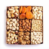 Assorted nuts in a wooden box royalty free stock photo