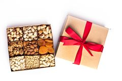 Assorted nuts in a wooden box royalty free stock images