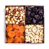 Assorted nuts in a wooden box stock photo