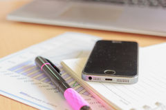 Assorted Office supplies such as  mobile, pen and diary Royalty Free Stock Photos