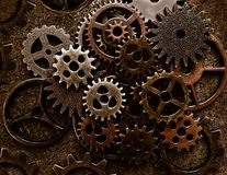 Assorted old metal grunge gears. Assortment of old metal gears on grunge background royalty free stock photography
