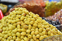 Assorted olives on the arab street market stall Stock Photos