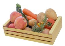 Assorted ordinary, common fruit and vegetables in wooden box isolated on white background. Home garden produce. Stock Image