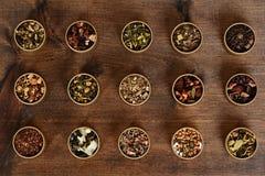 Assorted organic herbal tea in metal tins Royalty Free Stock Photo