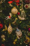 Assorted Ornaments on Christmas Tree Stock Images