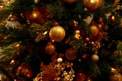 Golden Christmas Ornaments on Tree royalty free stock photos