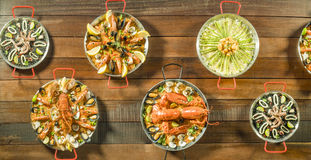 Assorted paella on wooden table, above view Stock Photography