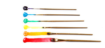 Assorted paint brushes with paint Stock Images