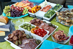 Assorted party trays of meats and vegetables Stock Photos