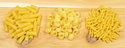 Assorted pasta. Assorted uncooked pasta on the wooden table Stock Photo